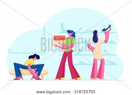 Young Woman Trying On Shoes Sitting On Couch Near Shelves With Footgear In Store. Young Girls Choose