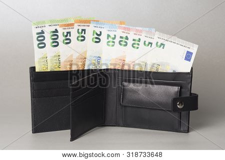 Euro Banknotes Paper Currency In Black Purse On Gray Background, Paying With Cash.