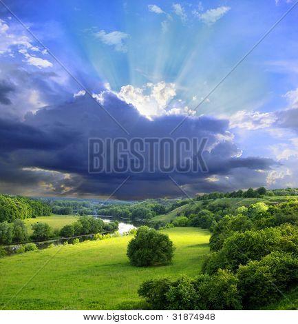 Landschap - weide, de blauwe lucht en de rivier