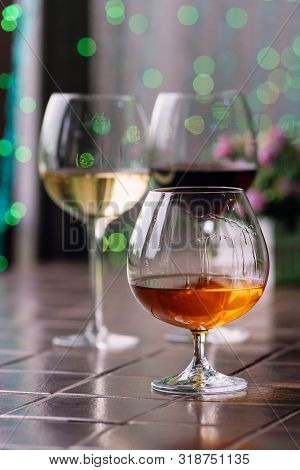 Brandy In Typical Snifter. Cognac In Elegant Glass With Space For Text On Colorful Background. Two G