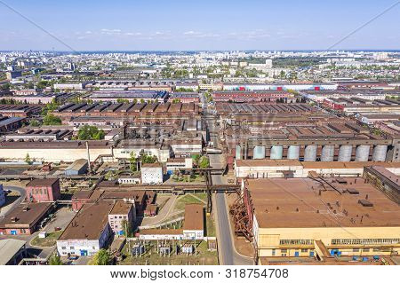Aerial View Of Industrial District With Manufacturing Buildings And Warehouses