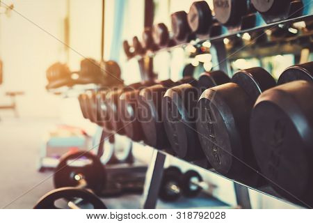 Dumbells Set For A Exercise In The Fitness Gym.