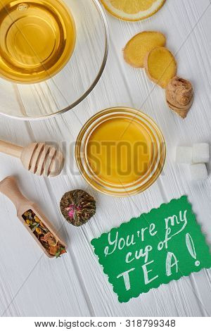Tea, Honey And Seasoning On Wooden Background. Flat Lay Composition With Herbal Tea, Honey, Ginger,