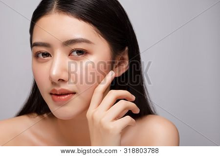 Portrait Of Beautiful Young Asian Woman Clean Fresh Bare Skin Concept. Asian Girl Beauty Face Skinca