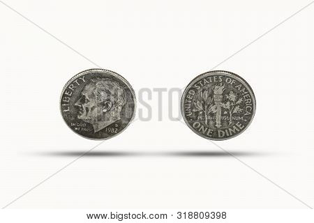Closeup Of One Dime Coin With Shadow On White Background. Us Dollar Is Worldwide Currency And Popula