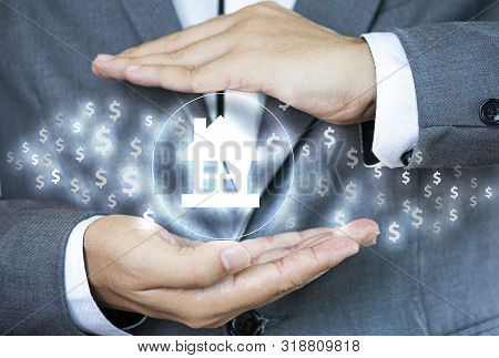 Businessman With Protective Gesture Hand For House. House Are Future Investment And Big Debt. Proper