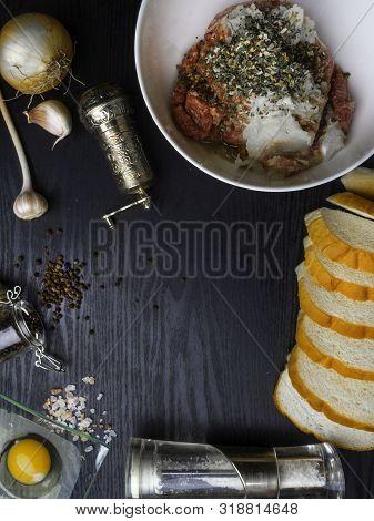Meat Patties, Rissole Ingredients: Raw Minced Meat , Raw Egg, Chopped Onion, Garlic, Bread, Herbs, S