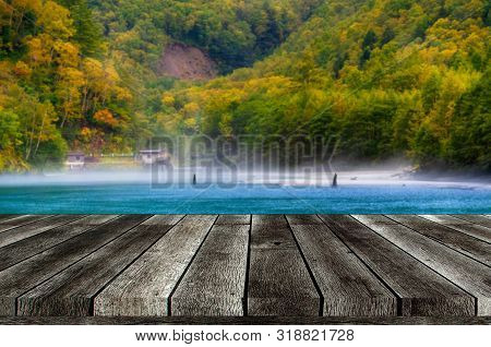 Empty Grey Wooden Table Or Wooden Terrace With Beautiful View Of Taisho Pond At Kamikochi National P