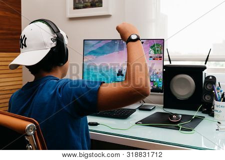 Madrid, Spain - August 23, 2019: Teenager Playing Fortnite Video Game On Pc. Fortnite Is An Online M