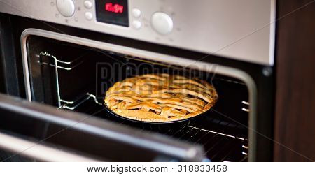 Baking Traditional Apple Pie In The Oven In The Kitchen