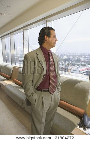Side view portrait of businessman at airport