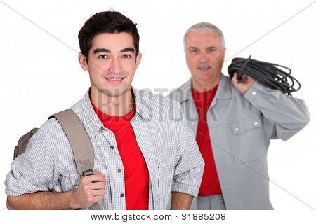 An apprentice standing near his boss
