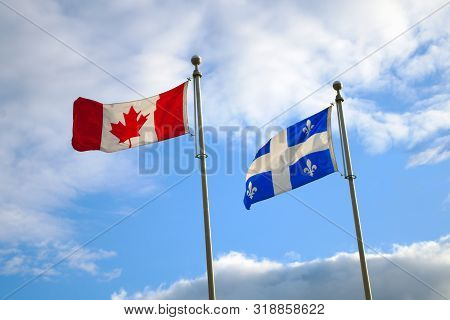 Quebec Canada Flags Waving In Blue Sky National French America