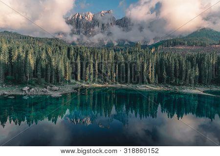 Moody Alpine Lake Carezza Or Lago Di Carezza In Dolomites Mountains, South Tyrol, Italy, Europe