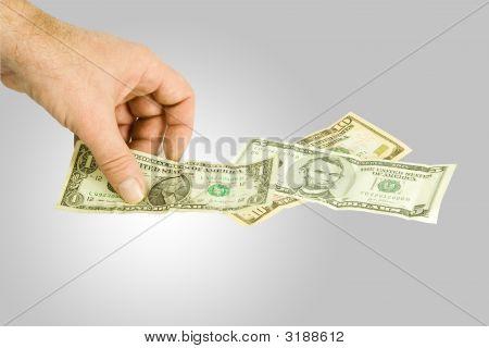 Picking Up Dollar Notas
