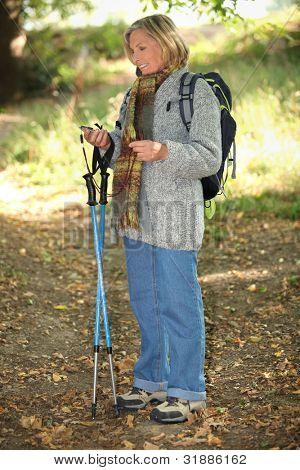 senior lady on a mountain hike