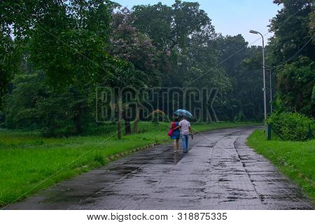 Romantic Couple In Monsoon, India