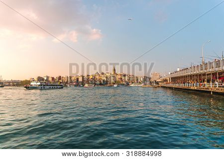April 17, 2019 :view Of Istanbul Cityscape Galata Tower With Floating Tourist Boats In Bosphorus ,is