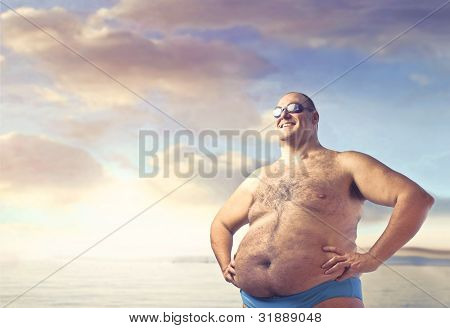 Smiling overweight man in bathing suit