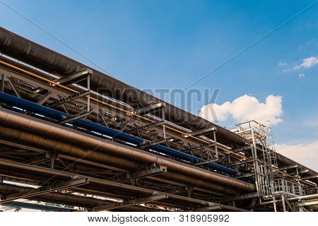 Outdoors Industrial Tiered Steel Flyover With Pipelines