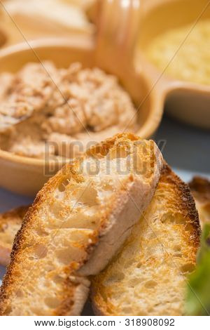 Roasted Bread Ciabatta And Herring Cream Cheese In Background