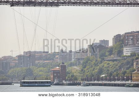 Bizkaia Red Iron Hanging Bridge And Nervion River. Euskadi, Spain