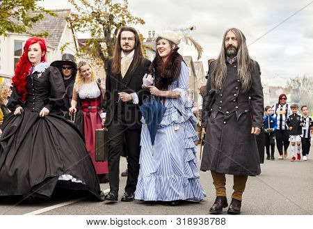 Llandudno, North Wales- 29th April 2017: People Dressed In Fancy Dress Costume Walking In A Parade I