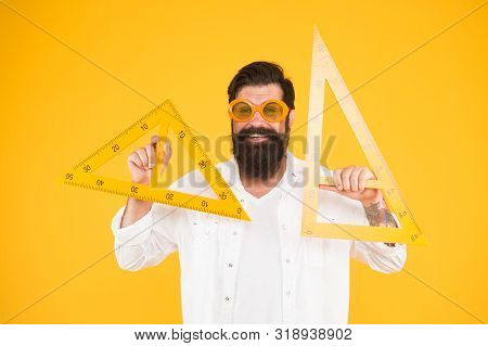 Man Math Lesson. Smart Student. College University Education. Bearded Nerd With Triangle. Exploring