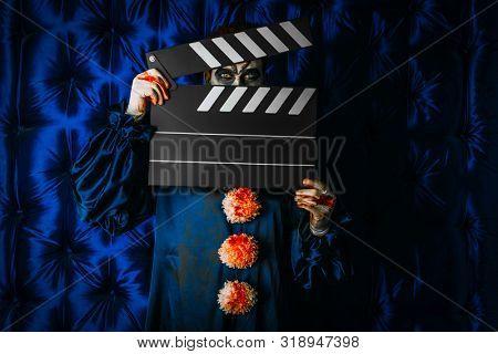 A portrait of a clown man. Actor, horror film. Halloween, carnival.