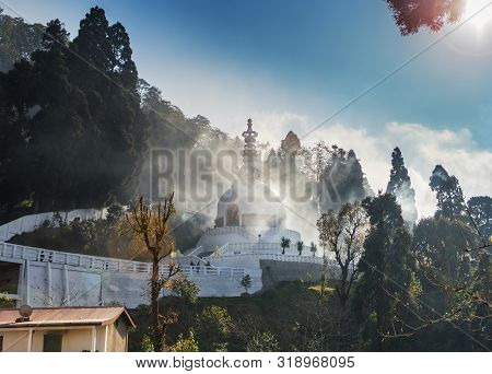Japanese Peace Pagoda, On The Top Of Mountain In The Darjeeling, In A Haze Of The Arising Clouds Whi
