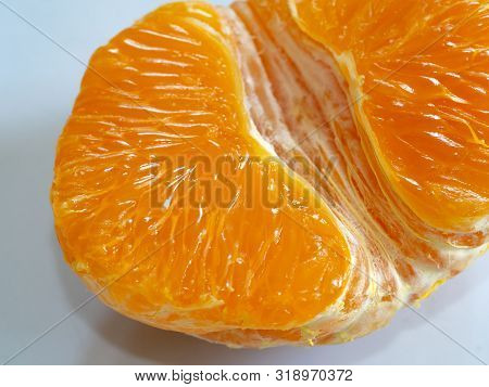 Half Of Peeled Tangerine Or Mandarin Macro, Part Of Fruit. Juicy Ripe Mandarin. Closeup. Mandarin Lo