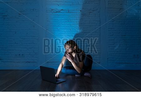 Teenager Man Suffering Internet Cyber Bullying Sitting Alone With Computer Feeling Hopeless