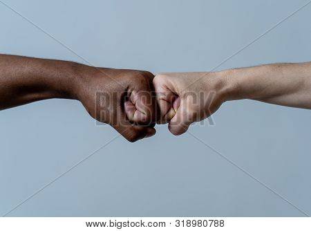 Fist Of Different Skin Colors Giving Fist Bump. Conceptual Image Of Race Tolerance And Stop Racism