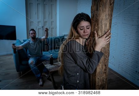 Woman Victim Of Domestic Violence And Abuse. Husband Intimidating His Wife