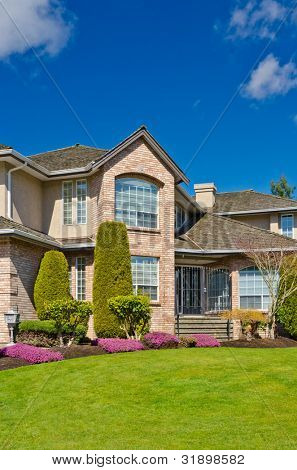 Luxury house with fantastic outdoor landscape at sunny day in Vancouver, Canada.