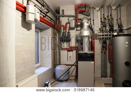 Autonomous Heating System In The Boiler Room. Boiler, Water Heater, Expansion Tank And Other Pipes,