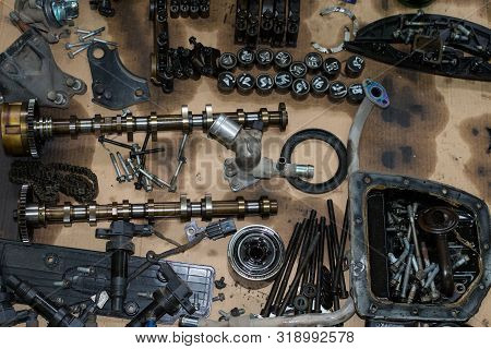 Old Disassembled Engine Parts, Camshaft, Engine Chain Bolts, Hydraulic Compensators, Oil Filter, Top