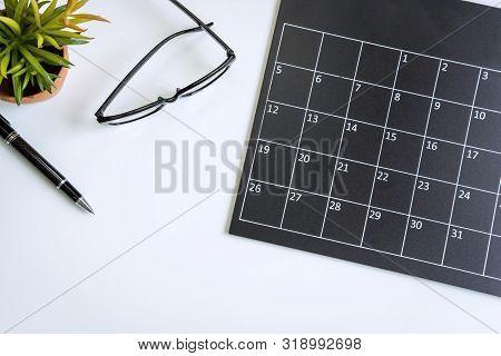 Planning Calendar On Business Desk Office, Top View
