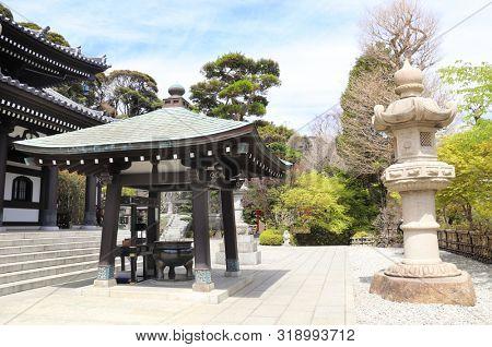 Ancient pavilion, stone lanterns and incense pot in Hasedera (Hase-dera) temple, Kamakura, Kanagawa prefecture, Japan