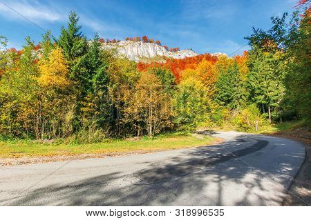 Serpentine Road In Apuseni Mountains, Pietrele Negre Romania. Rocky Cliff Above The Passage. Trees I