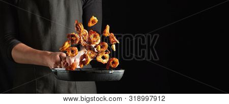 Professional Chef Prepares Shrimps Or Langoustines With Spices. Cooking Mediterranean Seafood, Healt