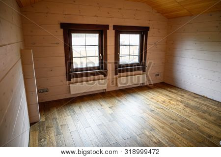 Empty Room In A New Wooden House, Walls Colored With Natural Paint .