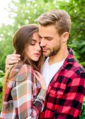 Enjoying intimacy. Cuddling with darling. Man hipster and pretty woman in love. Summer vacation. Fall in love. Pure feelings. Romantic date concept. Beautiful people. Happy together. Couple in love poster