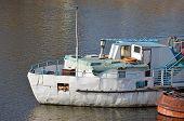Motor boat at small river harbor in Kiev Ukraine poster