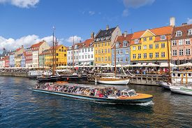 Copenhagen, Denmark - August 21, 2019: Famous Nyhavn District In The City Centre With Colorful House