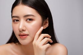 Portrait Of Beautiful Young Asian Woman Clean Fresh Bare Skin Concept. Asian Girl Beauty Face Skinca