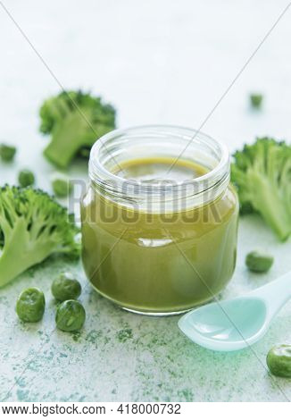 Baby Food. Organic Green Broccoli  Puree With Ingredients. Mashed Broccoli And Peas