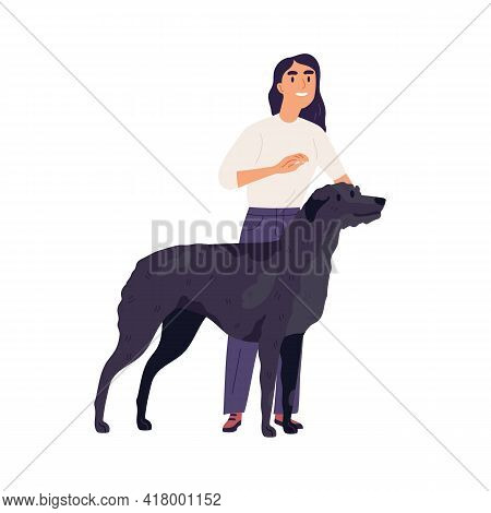Irish Wolfhound With Its Owner. Happy Person Standing With Tall Black Dog. Female Doggy Trainer And