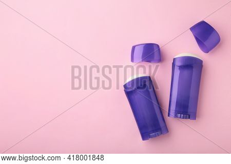 Violet Antiperspirant Deodorant On Pink Background. Skin Care Concept. Copy Space, Top View.