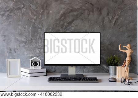Mock Up : Stylish Or Designer Workspace With Desktop Computer, Creative Supplies, Houseplant And Vin